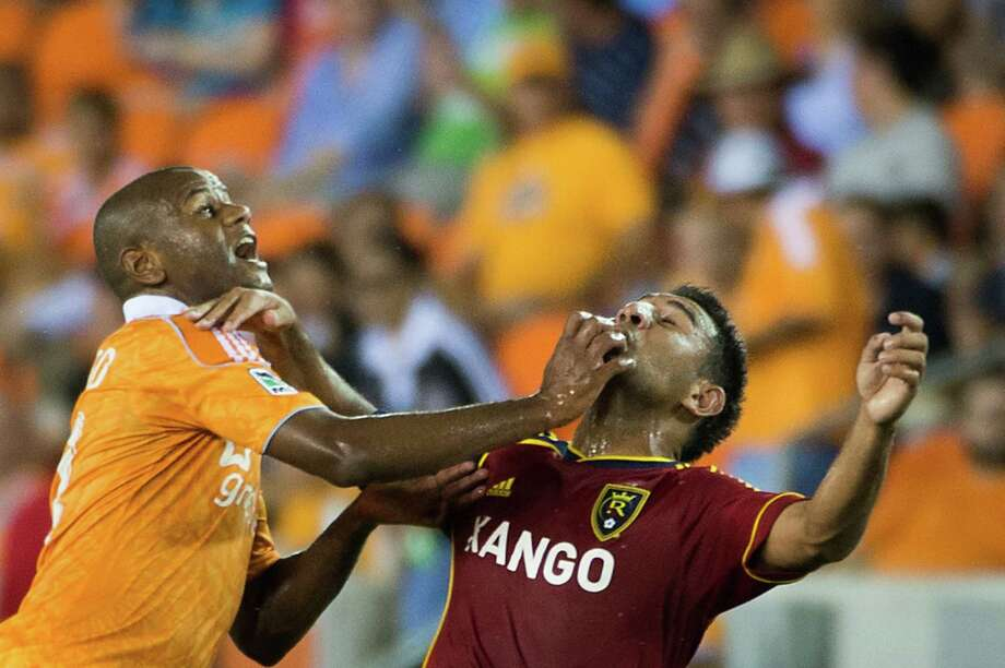 Houston Dynamo midfielder Luiz Camargo, left, and Real Salt Lake forward Paulo Jr. fight for position during an MLS soccer match on Thursday, Sept. 6, 2012, at BBVA Compass Stadium in Houston. Photo: Smiley N. Pool, Houston Chronicle / © 2012  Houston Chronicle