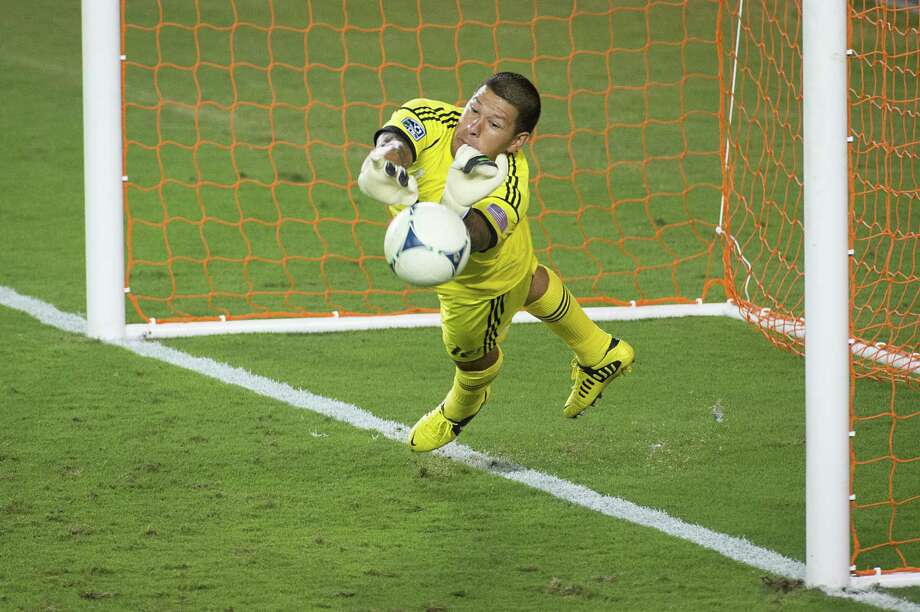 Real Salt Lake goalkeeper Nick Rimando makes a save on a penalty kick by Houston Dynamo midfielder Brad Davis during an MLS soccer match on Thursday, Sept. 6, 2012, at BBVA Compass Stadium in Houston. Photo: Smiley N. Pool, Houston Chronicle / © 2012  Houston Chronicle