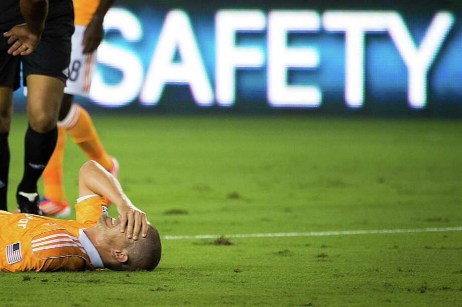 Houston Dynamo defender Bobby Boswell lies on the turf after being shaken up during an MLS soccer match against Real Salt Lake on Thursday, Sept. 6, 2012, at BBVA Compass Stadium in Houston. Photo: Smiley N. Pool, Houston Chronicle / © 2012  Houston Chronicle