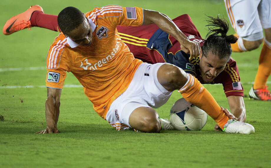 Houston Dynamo defender Ricardo Clark, left, makes a stop on Real Salt Lake forward Fabian Espindola during an MLS soccer match on Thursday, Sept. 6, 2012, at BBVA Compass Stadium in Houston. Photo: Smiley N. Pool, Houston Chronicle / © 2012  Houston Chronicle