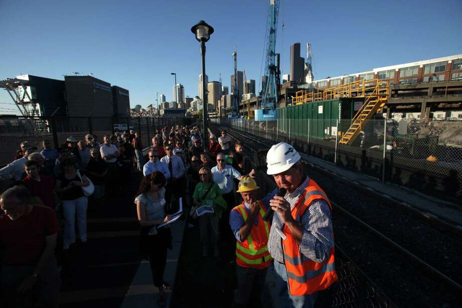 Consultant Chris Banbridge speaks to the public during a tour of the Highway 99 tunnel site along the Alaskan Way Viaduct as crews prepare for the arrival of the world's largest-diameter tunnel boring machine which will dig under downtown Seattle. The public was offered a tour of the site on Thursday, September 6, 2012. Photo: JOSHUA TRUJILLO / SEATTLEPI.COM