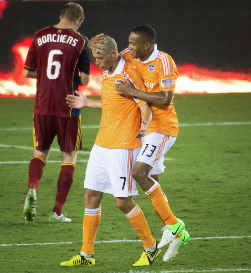 Houston Dynamo midfielder Colin Clark (7) celebrates with defender Ricardo Clark as Real Salt Lake defender Nat Borchers (6) walks away after a 1-0 victory in an MLS soccer match on Thursday, Sept. 6, 2012, at BBVA Compass Stadium in Houston. Colin Clark converted a penalty kick in stoppage time for the victory. Photo: Smiley N. Pool, Houston Chronicle / © 2012  Houston Chronicle
