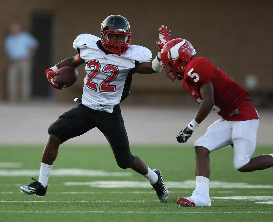 Terry 47, Dulles 36Terry's Eugene Wright (22) fends off Dulles' Jermaine Walker during the first half of a high school football game, Thursday, September 6, 2012 at Mercer Stadium in Sugar Land, TX. Photo: Eric Christian Smith, For The Chronicle