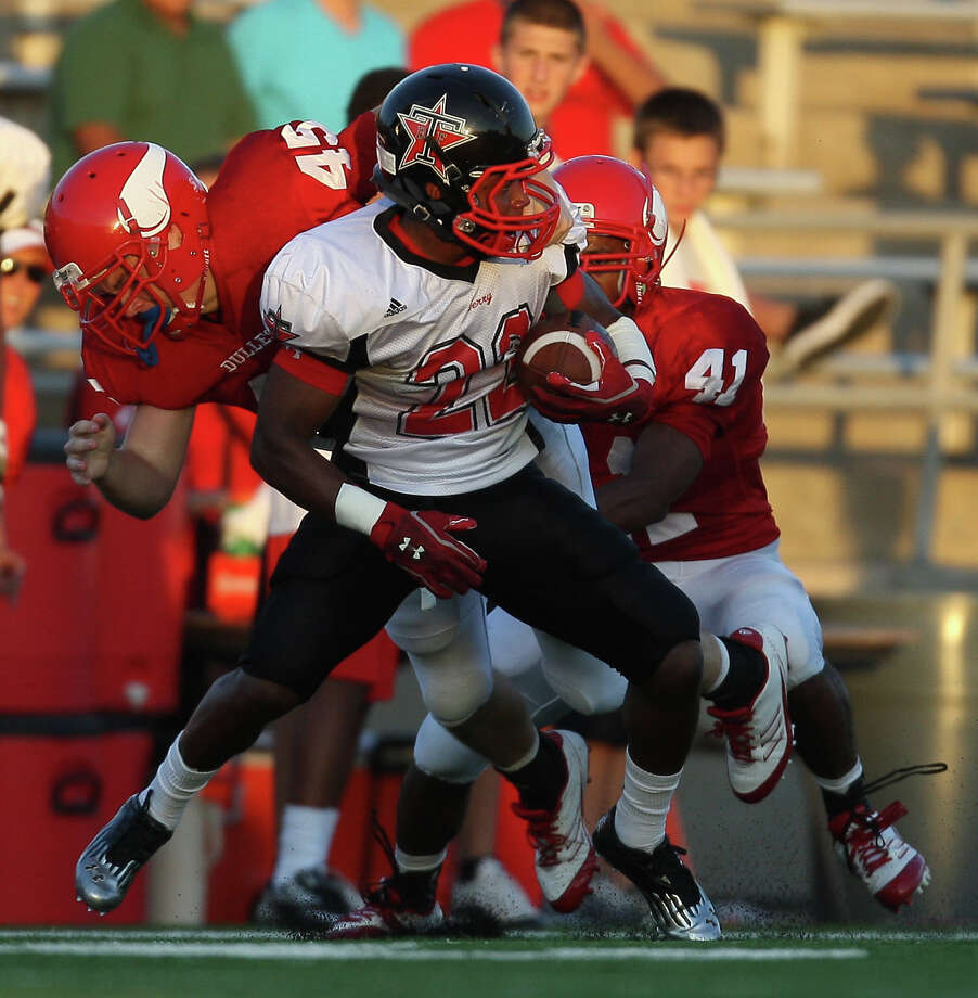 Terry's Eugene Wright (22) is tackled by Dulles' James Love (45) and Jonathan Marshall during the first half of a high school football game, Thursday, September 6, 2012 at Mercer Stadium in Sugar Land, TX. Photo: Eric Christian Smith, For The Chronicle