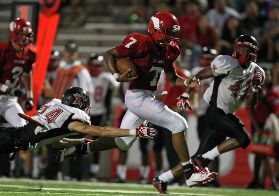 Dulles' Robert Harris scampers past Terry's Neilson Williams en route to a 30-yard touchdown during the first half of a high school football game, Thursday, September 6, 2012 at Mercer Stadium in Sugar Land, TX. Photo: Eric Christian Smith, For The Chronicle