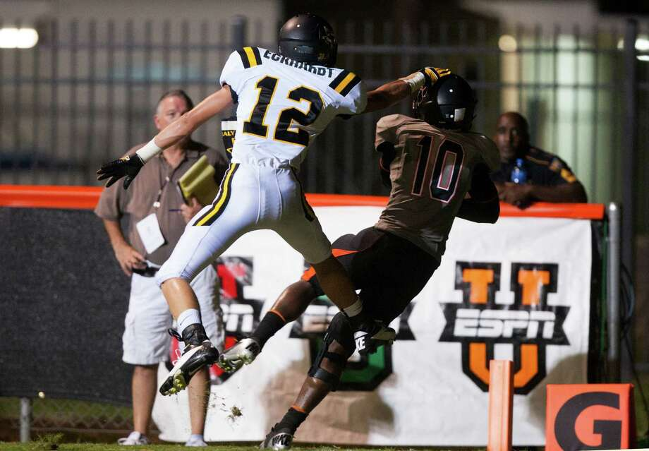 St. Pius wide receiver Damitri Morris (10) brings down a touchdown reception against Sealy defensive back Tyler Eckhardt (12) during the first half at Parsley Field on Thursday, Sept. 6, 2012, in Houston. Photo: J. Patric Schneider, Houston Chronicle / © 2012 Houston Chronicle