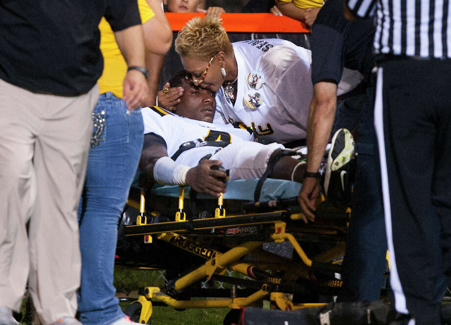 Sealy quarterback Ricky Seals-Jones (4) is hugged by his mother Buffy before being taken off by stretcher after being injured during the third quarter against St. Pius at Parsley Field on Thursday, Sept. 6, 2012, in Houston. Photo: J. Patric Schneider, Houston Chronicle / © 2012 Houston Chronicle