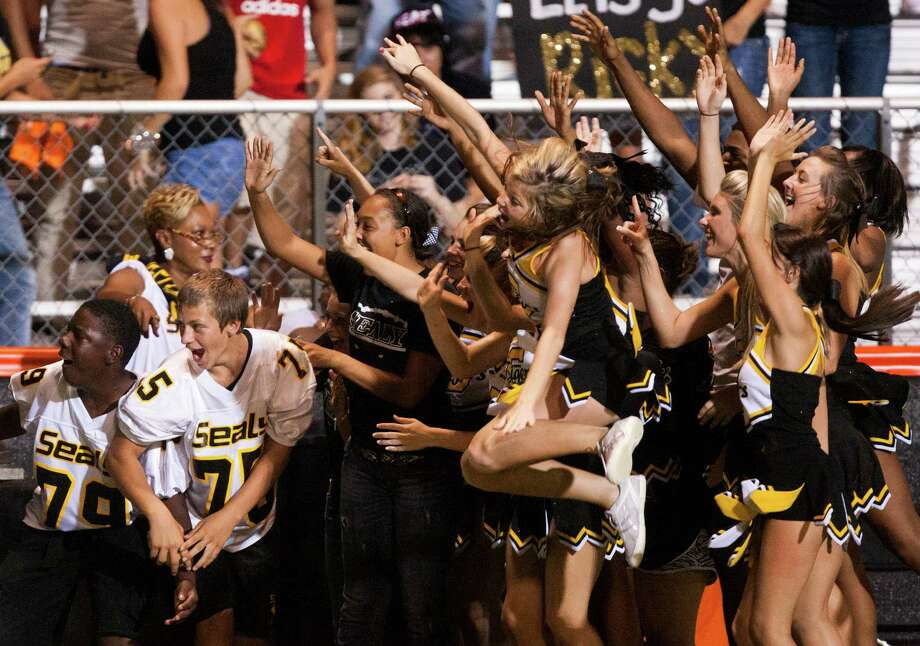 The Sealy cheerleaders cheer for an ESPNU crew at Parsley Field on Thursday, Sept. 6, 2012, in Houston. Photo: J. Patric Schneider, Houston Chronicle / © 2012 Houston Chronicle