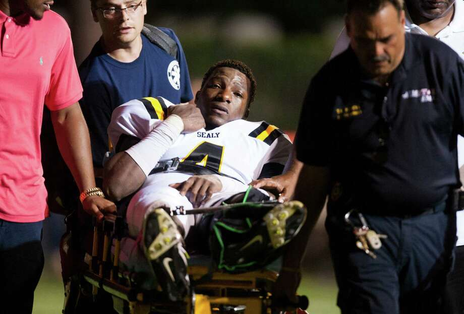 Sealy quarterback Ricky Seals-Jones (4) is taken off by stretcher after being injured during the third quarter against St. Pius at Parsley Field on Thursday, Sept. 6, 2012, in Houston. Photo: J. Patric Schneider, Houston Chronicle / © 2012 Houston Chronicle