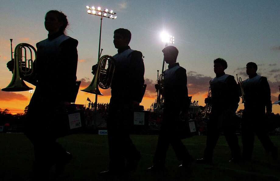 The Sealy band marches into Parsley Field as the football team prepares to face off against St. Pius on Thursday, Sept. 6, 2012, in Houston. Photo: J. Patric Schneider, Houston Chronicle / © 2012 Houston Chronicle