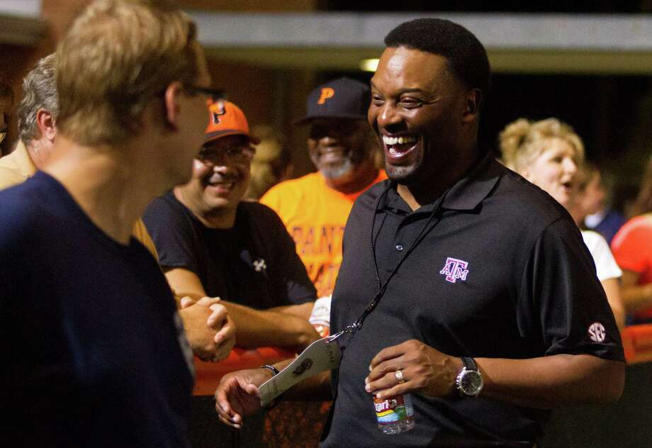 Texas A&M head football coach Kevin Sumlin visits with fans as St. Pius faces off against Sealy at Parsley Field on Thursday, Sept. 6, 2012, in Houston. Photo: J. Patric Schneider, Houston Chronicle / © 2012 Houston Chronicle