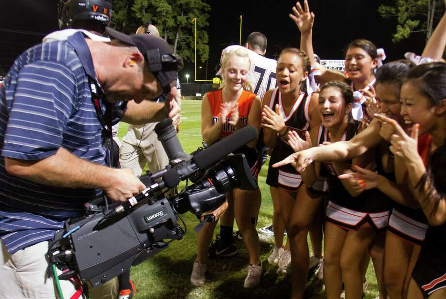 The St. Pius cheerleaders cheer for an ESPNU film crew as the football team faces off against the Sealy Tigers on Thursday, Sept. 6, 2012, in Houston. Photo: J. Patric Schneider, Houston Chronicle / © 2012 Houston Chronicle