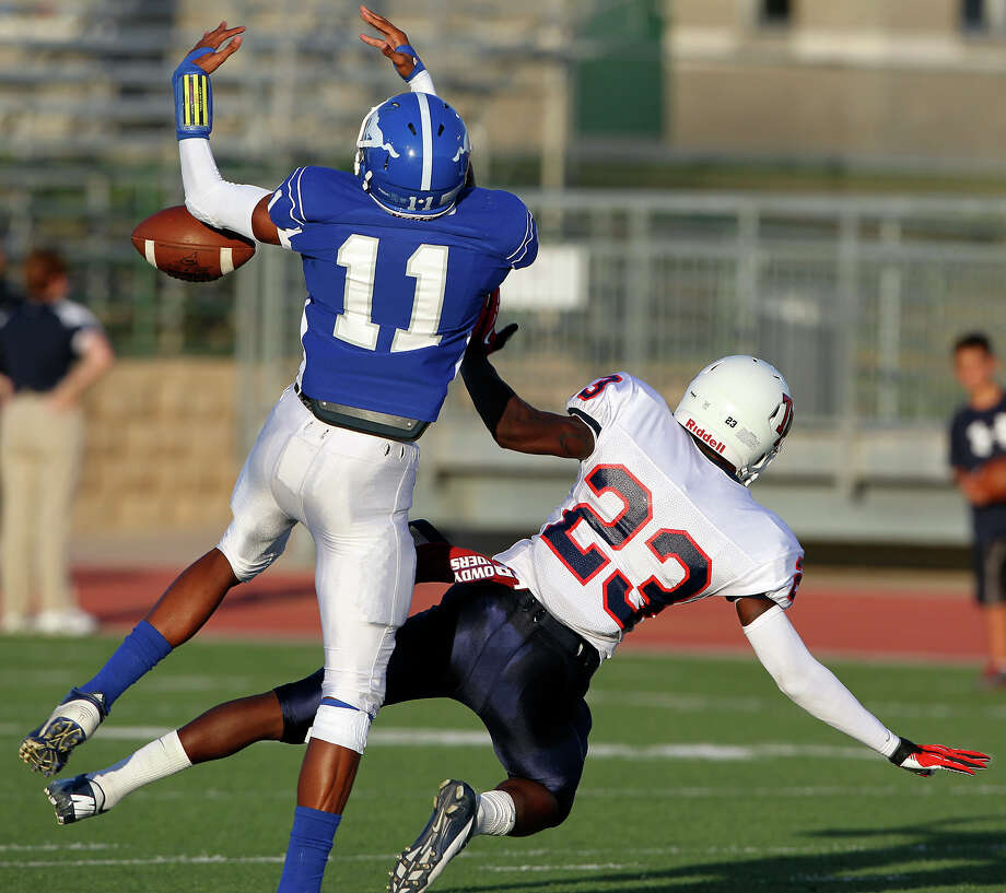 Mustang defender Josh Reynolds breaks up a pass to Carl Whitley as Jay plays Roosevelt at Gustafson Stadium on September 6, 2012. Photo: Tom Reel, San Antonio Express-News / ©2012 San Antono Express-News