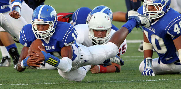 Josh Reynolds claims the ball after a Rough Rider fumble in the first half as Jay plays Roosevelt at Gustafson Stadium on Sept. 6, 2012. Photo: Tom Reel, San Antonio Express-News / ©2012 San Antono Express-News