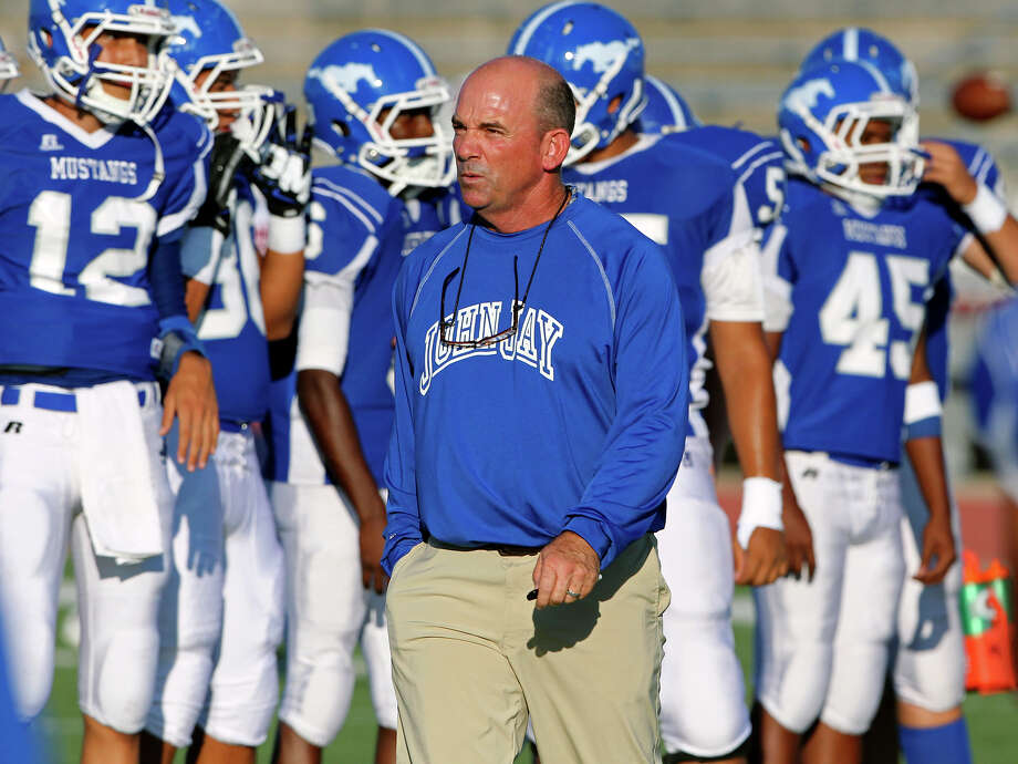 Mustang coach Bobby Goforth gets his players ready as Jay plays Roosevelt at Gustafson Stadium on September 6, 2012. Photo: Tom Reel, San Antonio Express-News / ©2012 San Antono Express-News
