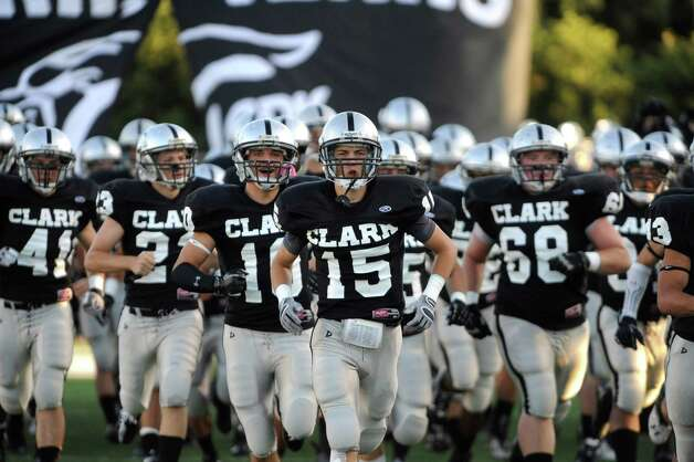 Clark receiver Presley Miller (15)  leads his teammates onto the field for their game against Alamo Heights at Farris Stadium on Thursday, Sept. 6, 2012. Photo: Billy Calzada, San Antonio Express-News / © San Antonio Express-News