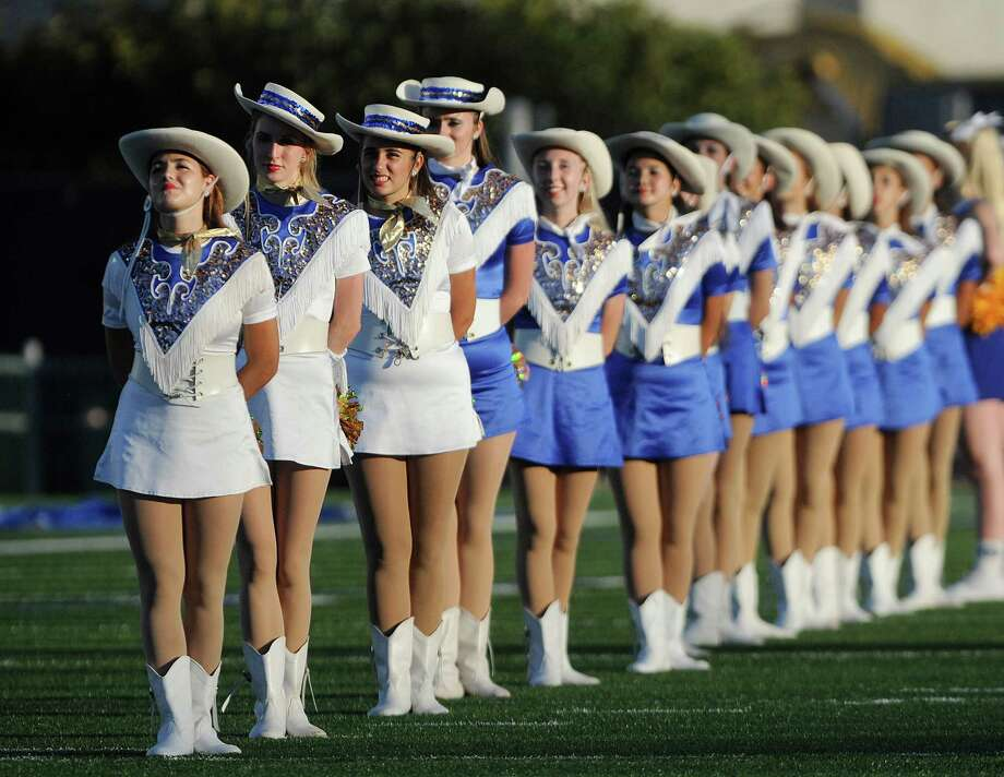 Members of the Alamo Heights Spurs line up before their football team's game against Clark at Farris Stadium on Thursday, Sept. 6, 2012. Photo: Billy Calzada, San Antonio Express-News / © San Antonio Express-News