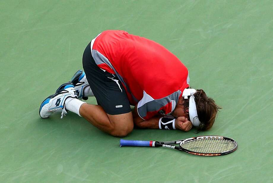 NEW YORK, NY - SEPTEMBER 06:  David Ferrer of Spain celebrates match point against Janko Tipsarevic of Serbia during their men's singles quarterfinal match Day Eleven of the 2012 US Open at USTA Billie Jean King National Tennis Center on September 6, 2012 in the Flushing neighborhood of the Queens borough of New York City.  (Photo by Cameron Spencer/Getty Images) Photo: Cameron Spencer, Getty Images