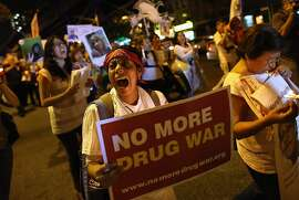 NEW YORK, NY - SEPTEMBER 06:  Protesters hold a candlelight vigil and a march calling for the end of the drug war on September 6, 2012 in the Harlem neighborhood of the Manahattan borough of New York City. Mexicans who have lost loved ones in their country's drug war joined with American supporters as part of  the Caravan for Peace with Justice and traveled some 6,000 miles through 25 cities, including Los Angeles, Houston, Atlanta and Chicago before arriving to New York. They protested the continued war on drugs on both sides of the U.S.- Mexico border, which has left tens of thousands of people dead. The caravan is due to arrive in Washington D.C. for its final stop September 10.  (Photo by John Moore/Getty Images)