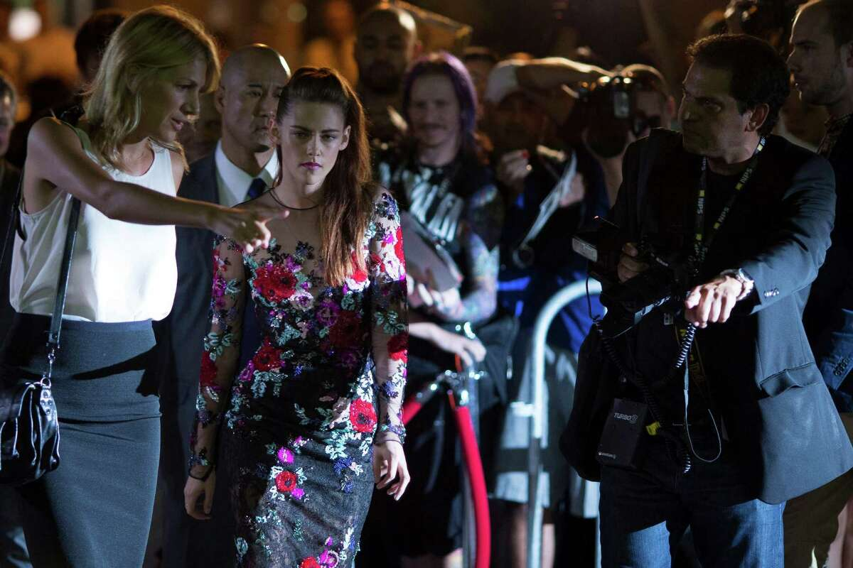 Kristen Stewart (center) is shown on the red carpet at the gala premiere for the movie
