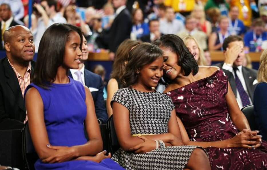 CHARLOTTE, NC - SEPTEMBER 06:  (L-R) Malia Obama, Sasha Obama, and First lady Michelle Obama listen