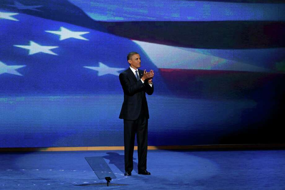 President Barack Obama stands on stage after addressing the Democratic National Convention in Charlotte, N.C., on Thursday, Sept. 6, 2012. (AP Photo/J. Scott Applewhite) Photo: J. Scott Applewhite