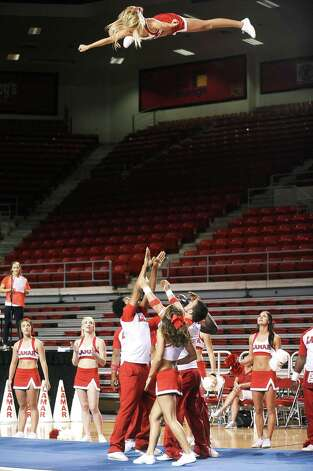 Lamar cheerleaders get the fans rowdy during the first pep rally at the Montagne Center on Thursday, September 6, 2012. Photo taken: Randy Edwards/The Enterprise Photo: Randy Edwards