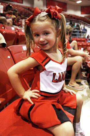 Macy Landry of Nederland shows her LU pride at the first pep rally at the Montagne Center on Thursday, September 6, 2012. Photo taken: Randy Edwards/The Enterprise Photo: Randy Edwards
