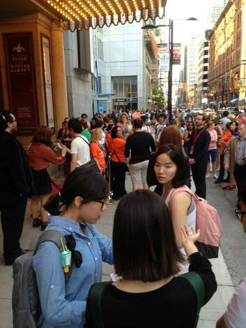 "The crowd builds Thursday night for the Toronto International Film Festival opener ""Looper."" (Paul Grondahl/Times Union)"
