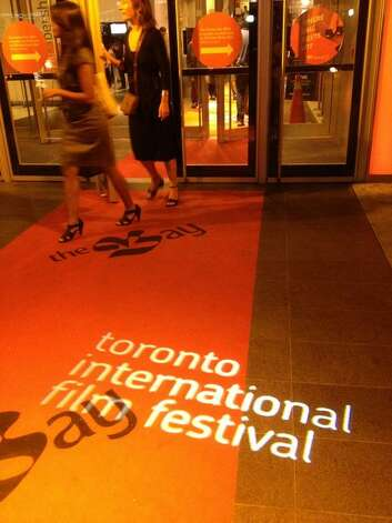 The films never stop at the Toronto International Film Festival. Patrons attend midnight madness showings Thursday night. (Paul Grondahl/Times Union)