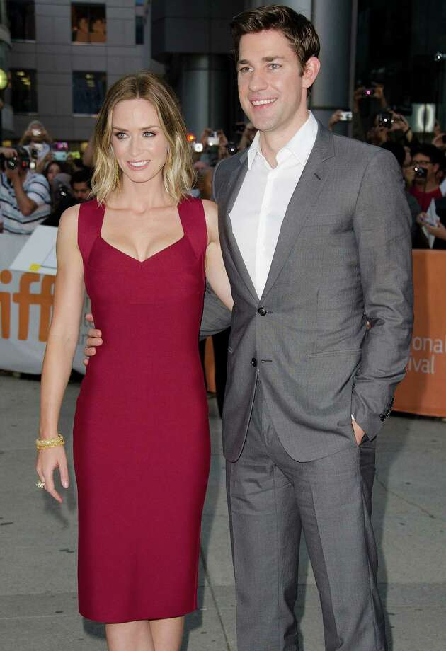 "Actress Emily Blunt, left, and her husband, actor John Krasinski attend the opening night gala premiere of ""Looper"" at Roy Thomson Hall during the 2012 Toronto International Film Festival on Thursday, Sept. 6, 2012, in Toronto. (Photo by Arthur Mola/Invision/AP) Photo: Arthur Mola"