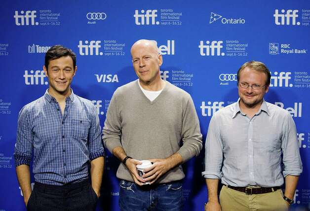 "Actors Joseph Gordon-Levitt, left, and Bruce Willis, pose with writer-director Rian Johnson before the press conference for their new movie ""Looper"" during the 2012 Toronto International Film Festival in Toronto on Thursday, Sept. 6, 2012. (AP Photo/The Canadian Press, Aaron Vincent Elkaim) Photo: Aaron Vincent Elkaim"