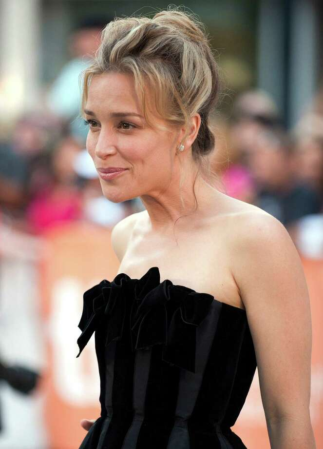"""Actress Piper Perabo attends the opening night gala premiere of """"Looper"""" at Roy Thomson Hall during the 2012 Toronto International Film Festival on Thursday, Sept. 6, 2012, in Toronto. (Photo by Arthur Mola/Invision/AP) Photo: Arthur Mola"""