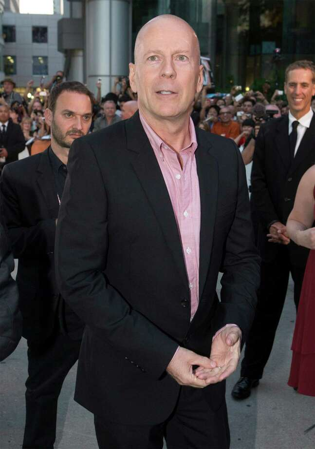 "Bruce Willis is shown on the red carpet at the gala premiere for the new movie ""Looper"" during the 2012 Toronto International Film Festival in Toronto on Thursday, Sept. 6, 2012. (AP Photo/The Canadian Press/Frank Gunn) Photo: Frank Gunn"