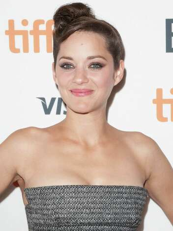 "Actress Marion Cotillard attends the premiere for ""Rust and Bone"" at the Elgin Theatre during the 2012 Toronto International Film Festival on Thursday, Sept. 6, 2012, in Toronto. Photo: Arthur Mola, ARTHUR MOLA/INVISION/AP / Invision"