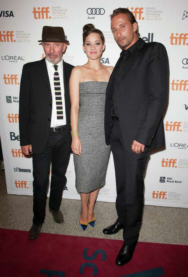 "Writer-director Jacques Audiard, left, actress Marion Cotillard and actor Matthias Schoenaerts attend the premiere for ""Rust and Bone"" at the Elgin Theatre during the 2012 Toronto International Film Festival on Thursday, September 6, 2012, in Toronto. Photo: Arthur Mola, ARTHUR MOLA/INVISION/AP / Invision"