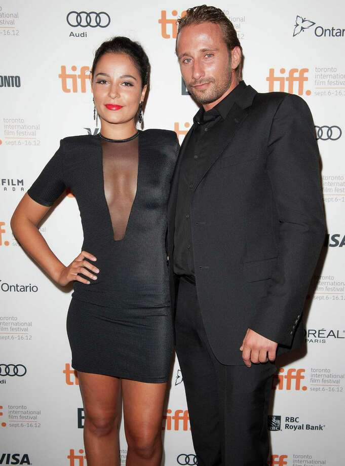 "Actor Matthias Schoenaerts, right, and a guest attend the premiere for ""Rust and Bone"" at the Elgin Theatre during the 2012 Toronto International Film Festival on Thursday, September 6, 2012, in Toronto. Photo: Arthur Mola, ARTHUR MOLA/INVISION/AP / Invision"