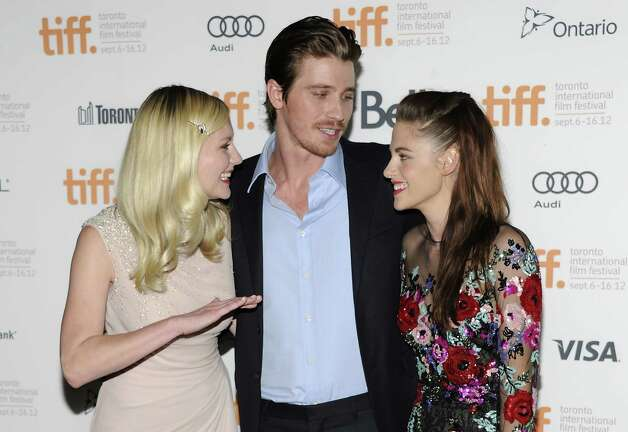 "Cast members Kirsten Dunst, left, Garrett Hedlund and Kristen Stewart are shown before the premiere of ""On the Road"" during the Toronto International Film Festival on Thursday Sept. 6, 2012 in Toronto. (Photo by Evan Agostini/Invision/AP) Photo: Evan Agostini, EVAN AGOSTINI /INVISION/AP / Invision"