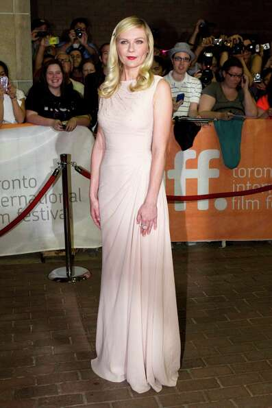 Kirsten Dunst poses for a photograph on the red carpet at the gala for the movie
