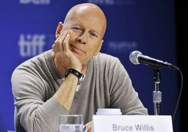 "Actor Bruce Willis smiles during the press conference for his new movie ""Looper"" during the 2012 Toronto International Film Festival in Toronto on Thursday, Sept. 6, 2012. Photo: Aaron Vincent Elkaim, AP / The Canadian Press"