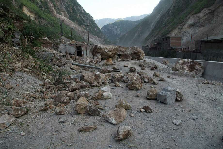 A rock-fall blocks a road in Yiliang, southwest China's Yunnan province on Friday, following two shallow quakes that struck the remote and mountainous border area of Yunnan and Guizhou province of southwest China.   Dozens of people were killed and 550 injured when two shallow quakes with a magnitude of both at 5.6 struck a remote and mountainous area of southwest China, toppling buildings and sparking chaos in the streets, officials said. ( AFP/AFP/GettyImages) Photo: AFP, Ap/getty / 2012 AFP