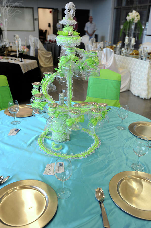 One of several table placements and centerpiece from the opening of the Event Centre in downtown Beaumont. Photo taken Tuesday, August 21, 2012 Guiseppe Barranco/The Enterprise Photo: Guiseppe Barranco, STAFF PHOTOGRAPHER / The Beaumont Enterprise
