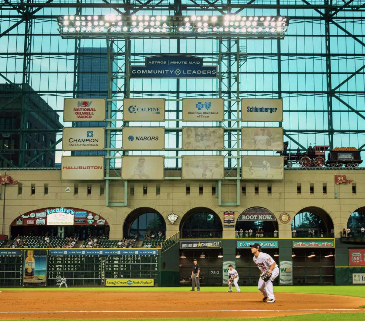New billboards at Minute Maid Park rise above the Crawford Boxes in left field. The billboards bear logos of corporate partners participating in the Astros Community Leaders Program, but the display itself has sparked criticism.