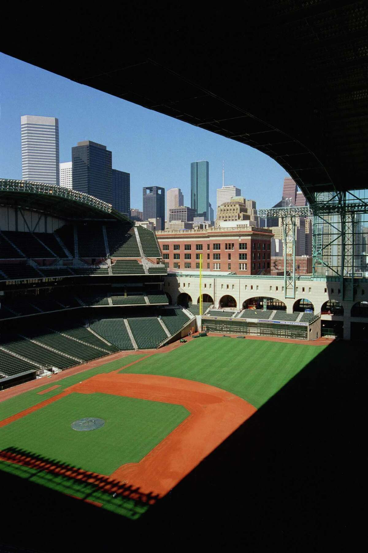 (Smiley N. Pool) -- The retractable roof peels back to unveil a spectacular downtown view from $12 seats in section 331 along the first base line on the Terrace Deck at Enron Field, photographed Saturday Mar. 11, 2000. HOUCHRON CAPTION (03/25/2000): Where can fans park? How much will a hot dog cost? How far away are the fences? These are just some of the questions answered in the Chronicle's 36-page guide to the opening of Enron Field. HOUCHRON CAPTION (03/26/2000): If you enjoy skylines as much as sliders, one of the $12 Terrace Deck seats (in this case, section 331) will enable you to keep one eye on the field and one on downtown Houston on a sunny afternoon. HOUSTON CHRONICLE SPECIAL SECTION: ENRON FIELD. HOUCHRON CAPTION (03/30/2000): The retractable roof peels back to reveal a spectacular downtown view from $12 seats in Section 331 along the first base line on the Terrace Deck at Enron Field.