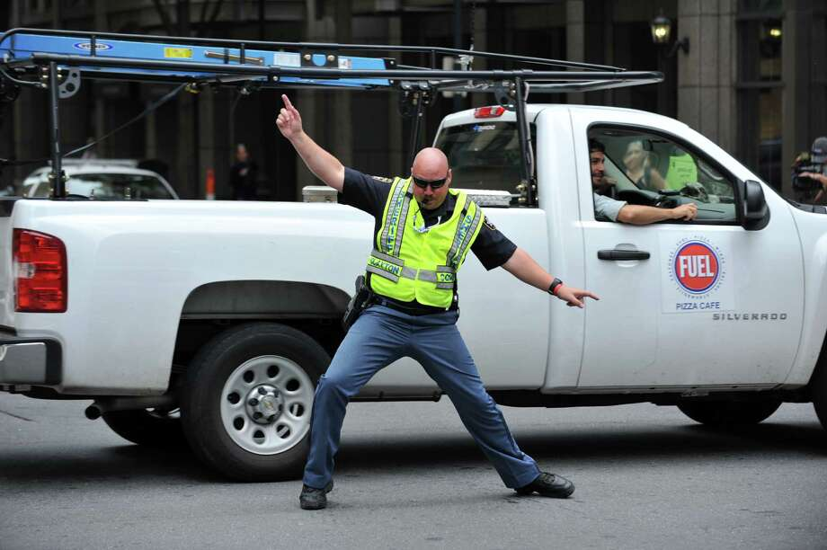 Sheriff Michael Johnson of Clayton County, Georgia directs traffic at t West 5th Street and North Tryon Street near the Time Warner Cable Arena on Thursday in Charlotte, N.C. on the final day of the 2012 Democratic National Convention. Johnson and his fellow sheriffs use humor in their moves as they direct traffic and pedestrians.         (STAN HONDA/AFP/GettyImages) Photo: Ap/getty