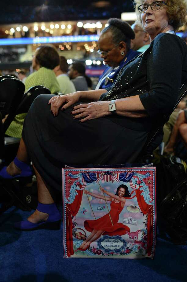 Janet Payne from Virginia displays a support poster for First Lady Michelle Obama at the Time Warner Cable Arena in Charlotte, N.C. on Tuesday on the first day of the Democratic National Convention .        (ROBYN BECK/AFP/GettyImages) Photo: Ap/getty
