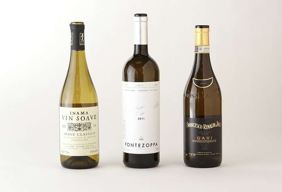 Three bottles of Italian white wines: Inama Soave, Fontezoppo Verdicchio, Francesco Rinaldi Gavi, left-right: as seen in San Francisco, California, on Wednesday, September 5, 2012. Photo: Craig Lee