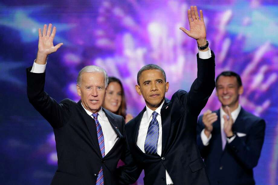Vice President Joe Biden and President Barack Obama wave to the delegates at the conclusion of Presdident Obama's speech at the Democratic National Convention in Charlotte, N.C., on Thursday, Sept. 6, 2012. (AP Photo/J. Scott Applewhite) Photo: J. Scott Applewhite, Associated Press / AP