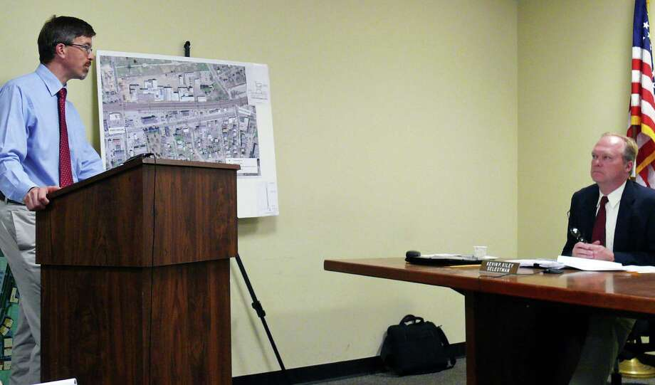Economic Development Director Mark Barnhart, left, presents a plan for streetscape improvements on the Post Road to the Board of Selectme, including Selectman Kevin Kiley, recently. Photo: Genevieve Reilly / Fairfield Citizen
