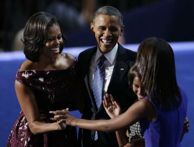 President Barack Obama laughs with his wife Michelle and his daughters Malia and Sasha after his speech to the Democratic National Convention in Charlotte, N.C., on Thursday, Sept. 6, 2012. (AP Photo/Lynne Sladky) (Associated Press)